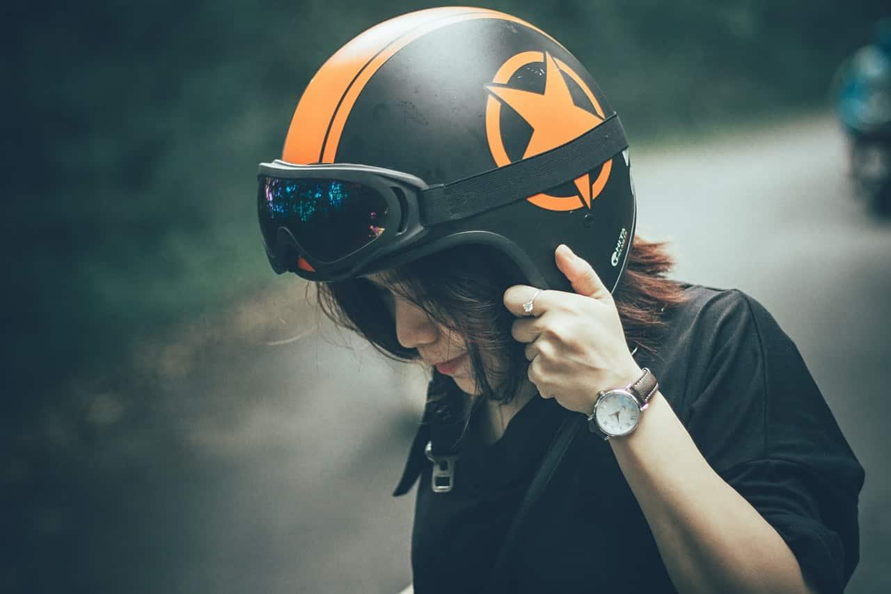 woman wearing an open face motorcycle helmet