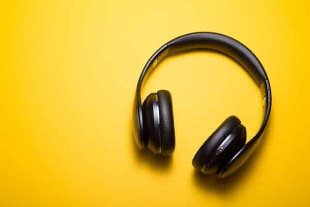 black music headphones yellow background